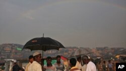 A rainbow forms in the horizon, as Rohingya refugees gather at Thangkhali refugee camp in Cox's Bazar, Bangladesh, Oct. 5, 2017.