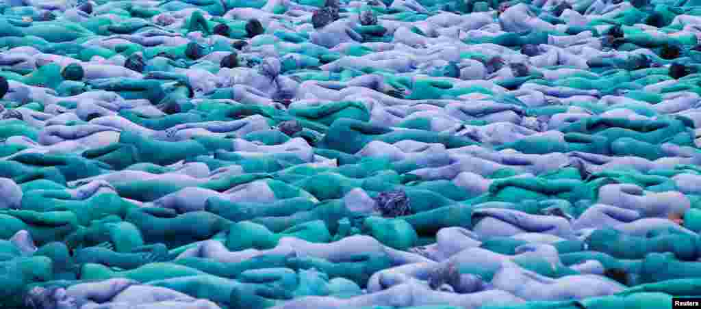 "Nude models pose for a photograph by U.S. artist Spencer Tunick, for a project titled ""Sea of Hull"" in Hull city center, northern England."