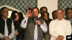 Former Prime Minister and leader of the Pakistan Muslim League-N party Nawaz Sharif, center, addresses his supporters at a party office in Lahore, May 11, 2013.