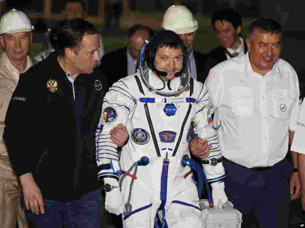 Russian cosmonaut Oleg Kononenko prepares to board the Soyuz TMA-17M rocket a few hours before the launch to the International Space Station, at the Russian leased Baikonur Cosmodrome, in Kazakhstan, July 23, 2015.