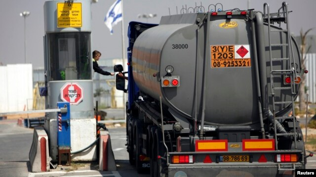 FILE - A tanker loaded with fuel for Gaza enters the Kerem Shalom crossing between Israel and the southern Gaza Strip, April 4, 2012.