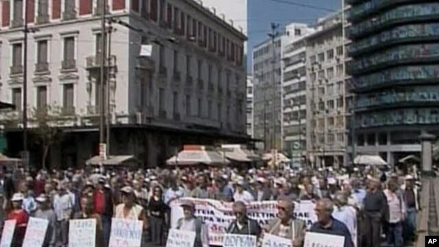 Citizens in Greece take to the streets to protest the cut in retirement pensions as the nation faced possible bankruptcy