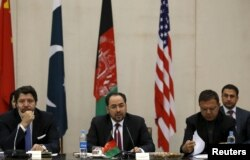 Afghanistan's Foreign Minister Salahuddin Rabbani, center, speaks during a one-day meeting with Pakistan, U.S. and Chinese delegations in Kabul, Jan. 18, 2016. The talks are aimed at ending the country's 15 years of war with the Taliban.