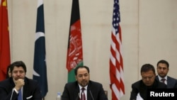 FILE - Afghanistan's Foreign Minister Salahuddin Rabbani, center, speaks during a one-day meeting with Pakistan, U.S. and Chinese delegations in Kabul, Jan. 18, 2016. The talks are aimed at ending the country's 15 years of war with the Taliban.