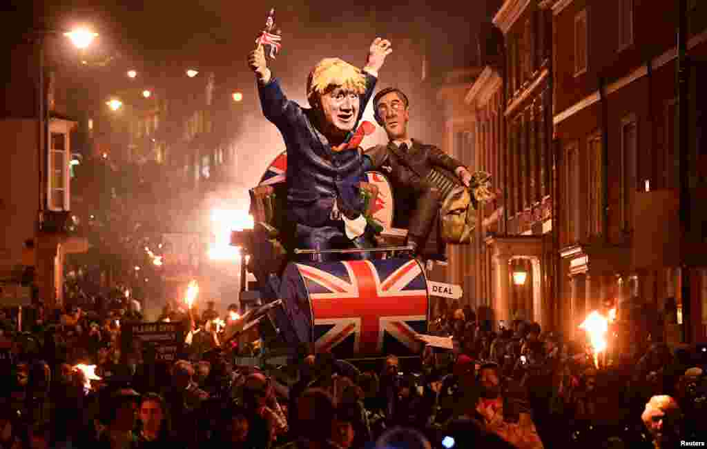 Effigies of Britain's Prime Minister Boris Johnson and Leader of the House of Commons Jacob Rees-Mogg are paraded through the town during the annual Bonfire Night festivities in Lewes, Britain, Nov. 5, 2019.