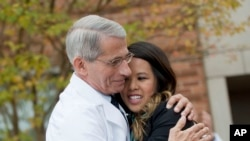 Dr. Anthony Fauci hugs Nina Pham as she's discharged from the National Institutes of Health, Oct. 24, 2014.