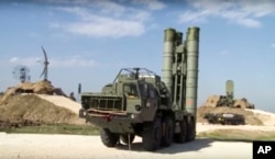 This photo made from the footage taken from the Russian Defense Ministry official web site on Nov. 27, 2015, shows Russian S-400 air defense missiles being deployed at the Hemeimeem air base in Syria.