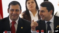 Paraguay's President Federico Franco,right, talks to Congress' Lower House President, Victor Bogado, during the presentation of his new government to Congress in Asuncion, June 27, 2012.