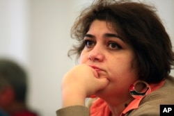 FILE - Khadija Ismayilova, a reporter for Radio Free Europe/Radio Liberty, is serving a seven-year prison sentence in Azerbaijan..