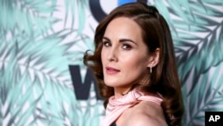 "FILE - In this Feb. 24, 2017, file photo, Michelle Dockery arrives at the 10th Annual Women in Film Pre-Oscar Cocktail Party at Nightingale Plaza in Los Angeles. Filming has begun for the ""Downtown Abbey"" movie. Dockery, who plays Lady Mary in the global hit, posted a photo on Instagram with the caption, ""And...we're off."""