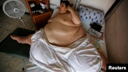 The late Manuel Uribe, once known as the world's largest man, talks on the phone at his home in the suburb of San Nicolas de los Garza, in Monterrey, Mexico, Aug. 8, 2008.