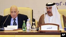 Arab League Secretary-General Nabil Elaraby and Qatar's Prime Minister and Foreign Minister Hamad bin Jassim bin Jabr Al-Thani (R) attend a meeting of the Committee of Arab Coordination in Doha (December 2011 file photo)