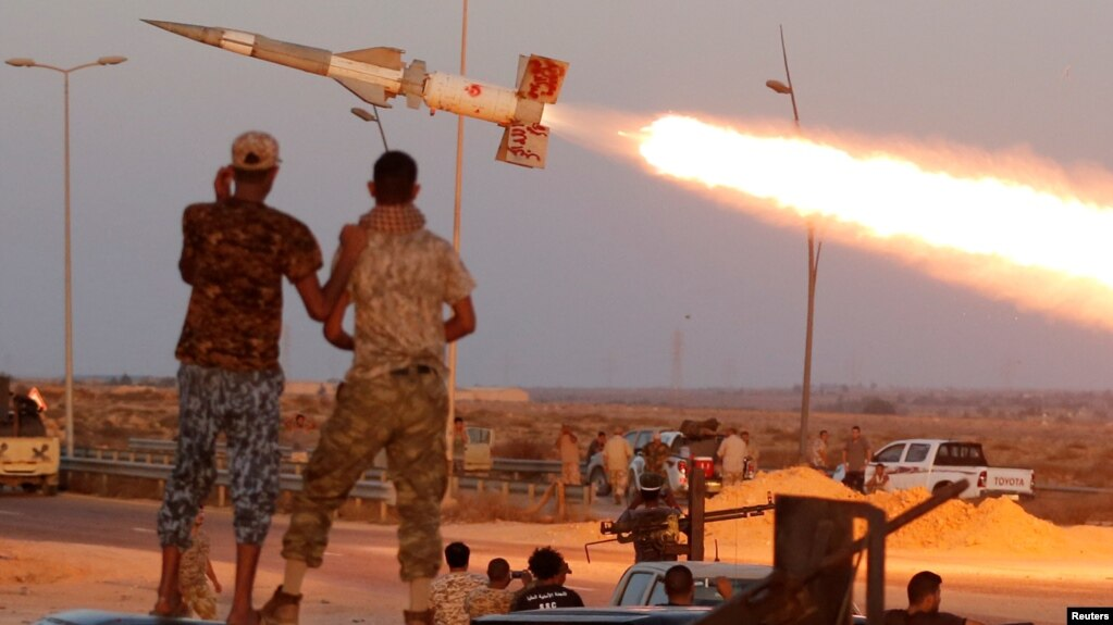 Libya getting more us help in fight against islamic state fighters of libyan forces allied with the un backed government fire a rocket at islamic sciox Choice Image