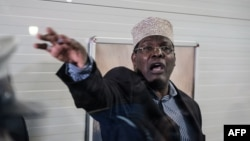 Kenyan opposition politician Miguna Miguna, who also holds Canadian citizenship and travels on a Canadian passport, reacts after Kenyan immigration authorities denied him entry into the country without a Kenyan visa, at Jomo Kenyatta International Airport