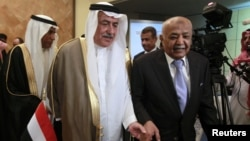 Yemen's Prime Minister Mohammed Salem Basindwa, right, with Saudi Arabia's Finance Minister Ibrahim al-Assaf at international donor meeting, Riyadh, Sept. 4, 2012.