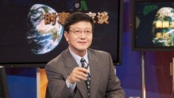 VOA Chinese TV Anchor Xu Bo hosting TV Talk Show Issues & Opinions.