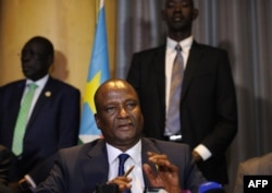 FILE - Newly appointed South Sudan first vice president, Taban Deng Gai (C) speaks during a press conference in Nairobi, Kenya, Aug. 17, 2016.