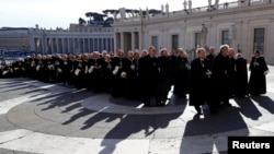 FILE - Members of the Order of the Knights of Malta arrive in St. Peter's Basilica for their 900th anniversary at the Vatican, Feb. 9, 2013.