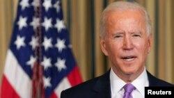 រូបឯកសារ៖ ប្រធានាធិបតីសហរដ្ឋអាមេរិកលោក Joe Biden និយាយអំពីរបៀបវារៈសមធម៌ជាតិសាសន៍នៅសេតវិមានក្នុងរដ្ឋធានីវ៉ាស៊ីនតោន សហរដ្ឋអាមេរិក កាលពីថ្ងៃទី២៦ ខែមករា ឆ្នាំ២០២១។
