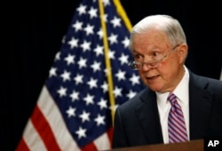 FILE - Attorney General Jeff Sessions speaks at a news conference in Baltimore, Dec. 12, 2017.