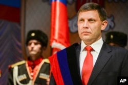FILE - In this Nov. 4, 2014, photo, rebel leader Alexander Zakharchenko attends a swearing in ceremony in Donetsk, Ukraine.