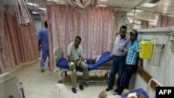 Người bị thương trong vụ đánh bom xe nằm trong bệnh viện ở Baghdad, ngày 12/10/2011