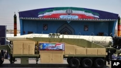 Iran's Khoramshahr missile is displayed by the Revolutionary Guard during a military parade marking the 37th anniversary of Iraq's 1980 invasion of Iran, in front of the shrine of late revolutionary founder Ayatollah Khomeini, near Tehran, Iran, Sept. 22,