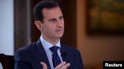 敘利亞總統阿薩德7月14日資料照。