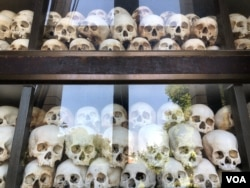 Skulls of victims from the Khmer Rouge period are kept at Choeung Ek killing fields in Phnom Penh, Cambodia. (Sun Narin/VOA Khmer)