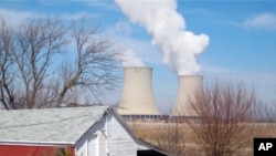 FILE - In this March 16, 2011 file photo, steam is released from Exelon Corp.'s nuclear plant in Byron, Illinois.