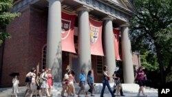 File - A tour group walks through the campus of Harvard University in Cambridge, Massachusetts.