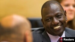 FILE - Kenyan Deputy President William Ruto speaks to his attorney at the International Criminal Court in The Hague, Sept. 10, 2013.