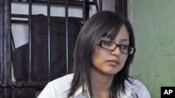 Marisol Valles, 20, sits at her desk at the police station in Praxedis G. Guerrero (file photo)