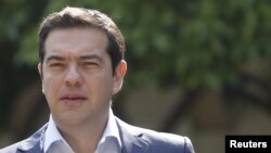 Greek Prime Minister Alexis Tsipras leaves Maximos Mansion for a meeting with party leaders at the Presidential Palace in central Athens, Greece, July 6, 2015.