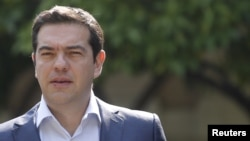 Greek Prime Minister Alexis Tsipras leaves Maximos Mansion to meet with party leaders at the Presidential Palace in central Athens, Greece, July 6, 2015.