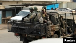 Soldiers of Ivory Coast's special forces drive through the city of Adiake, Ivory Coast, Feb. 7, 2017.