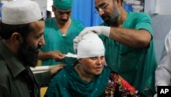 An injured woman is treated at a hospital in Peshawar, Pakistan, Oct. 26, 2015, following a massive earthquake in South Asia.