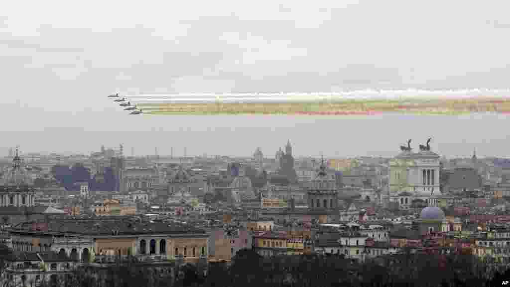 The 'Frecce Tricolori', the Italian Air Force acrobatic team flies over Rome to mark the 154th anniversary of the Italian Unification in 1861.