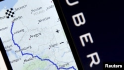 FILE - Nokia Maps is seen on a smartphone in front of a displayed logo of Uber in this May 8, 2015 photo illustration.