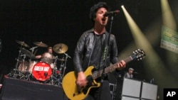 FILE - Billie Joe Armstrong of Green Day performs at the SXSW Music Festival, March 15, 2013.