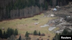 Foto udara kawasan yang terkena tanah longsor dekat kota Oso, negara bagian Washington, AS (27/3).
