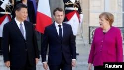 Rais wa Ufaransa Emmanuel Macron, Kansela wa Ujerumani Angela Merkel na Rais wa China Xi Jinping
