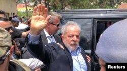 Former Brazilian President Luiz Inacio Lula da Silva leaves for the cemetery to attend the funeral of his 7-year-old grandson, in Sao Bernardo do Campo, Brazil, March 2, 2019.
