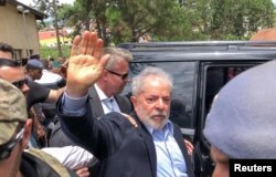 FILE - Former Brazilian President Luiz Inacio Lula da Silva leaves for the cemetery to attend the funeral of his 7-year-old grandson, in Sao Bernardo do Campo, Brazil, March 2, 2019.