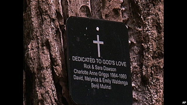 A small bronze plaque on the tree lists the people buried there as well as their dates of birth and when they died.