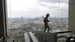 A worker walks at an apartment construction site in Jakarta, Indonesia (file photo)