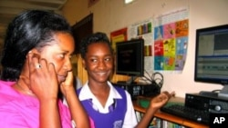 A student shows off technology in Jamaica.