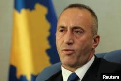 FILE - Kosovo's Prime Minister Ramush Haradinaj talks during an interview with Reuters in Pristina, Kosovo, Oct. 16, 2017.