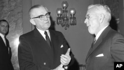 Sen. John Stennis, left, is seen with then CIA director John McCone before the start of a session of the Senate Armed Services Subcommittee, on Capitol Hill in Washington, Feb. 7, 1963.