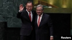 United Nations Secretary-General Ban Ki-moon (left) and Secretary-General-designate Antonio Guterres stand together after the swearing-in ceremony at U.N. headquarters in New York, Dec. 12, 2016.